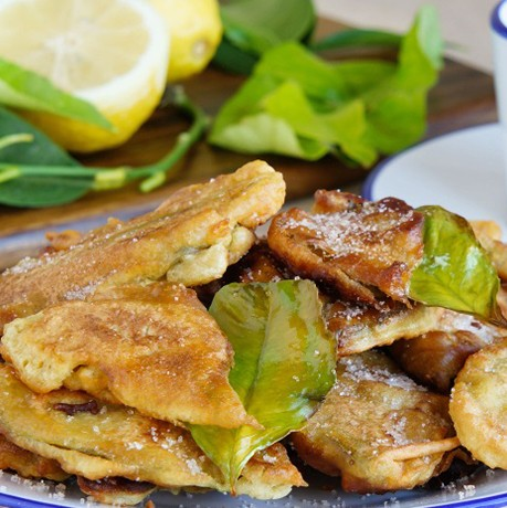 Paparajotes - typical dessert of Murcia, made of lemon leaves covered with dough, sprinkled with powdered sugar and cinnamon TFGP.